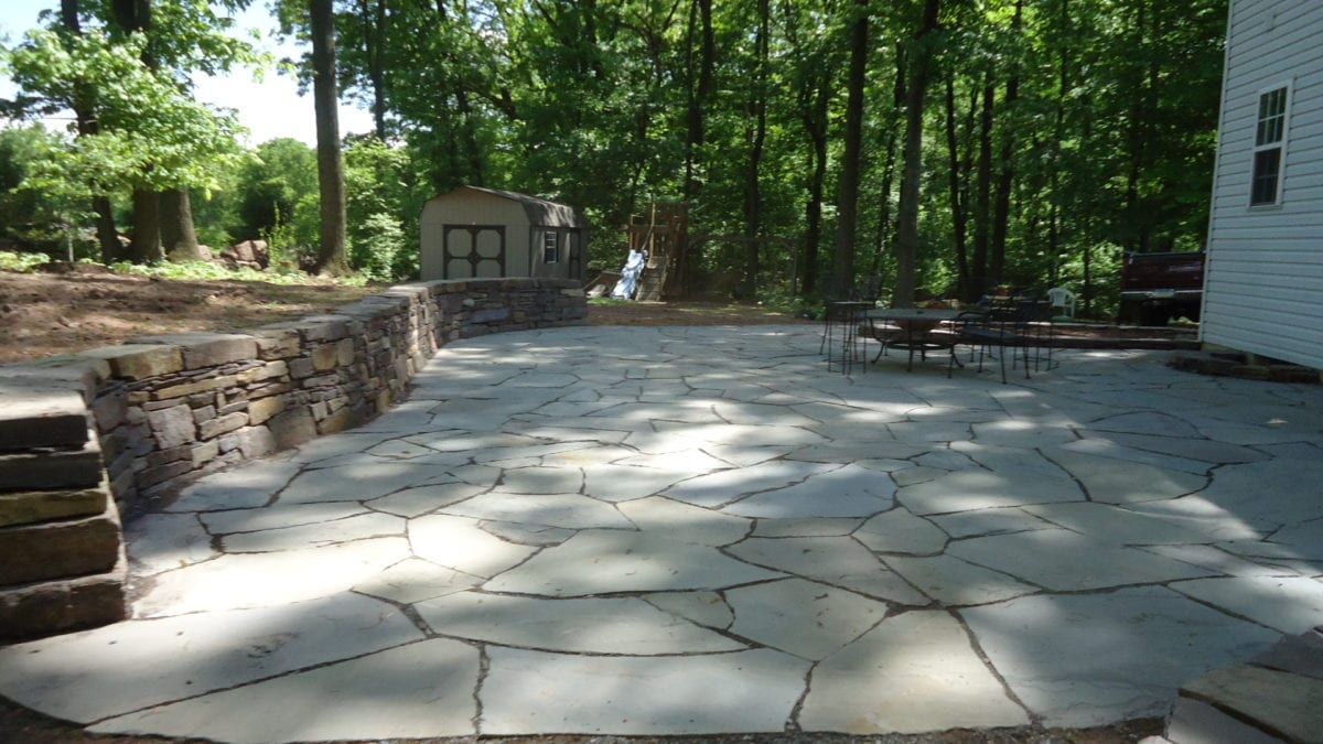 Flagstone Patio With Stone : Dry stone walls retaining masonry