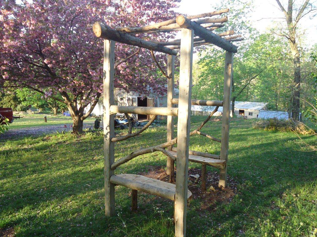 Rustic Log Arbor in Schwenksville, PA by Devin Devine