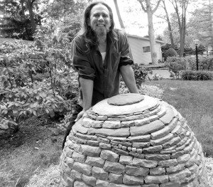 devin with stone sphere sculptures
