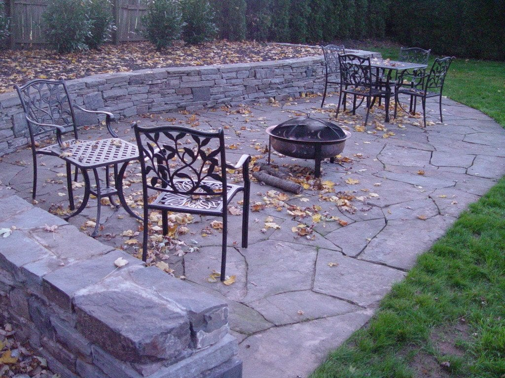 Flagstone patio and sitting wall, Abington PA by the mason at Devine Escapes