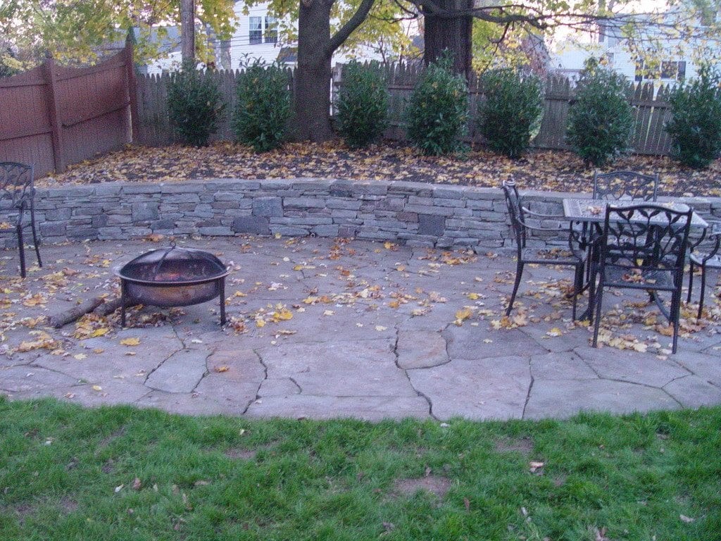 Natural flagstone patios on the main line devine escapes for Pictures of stone patios