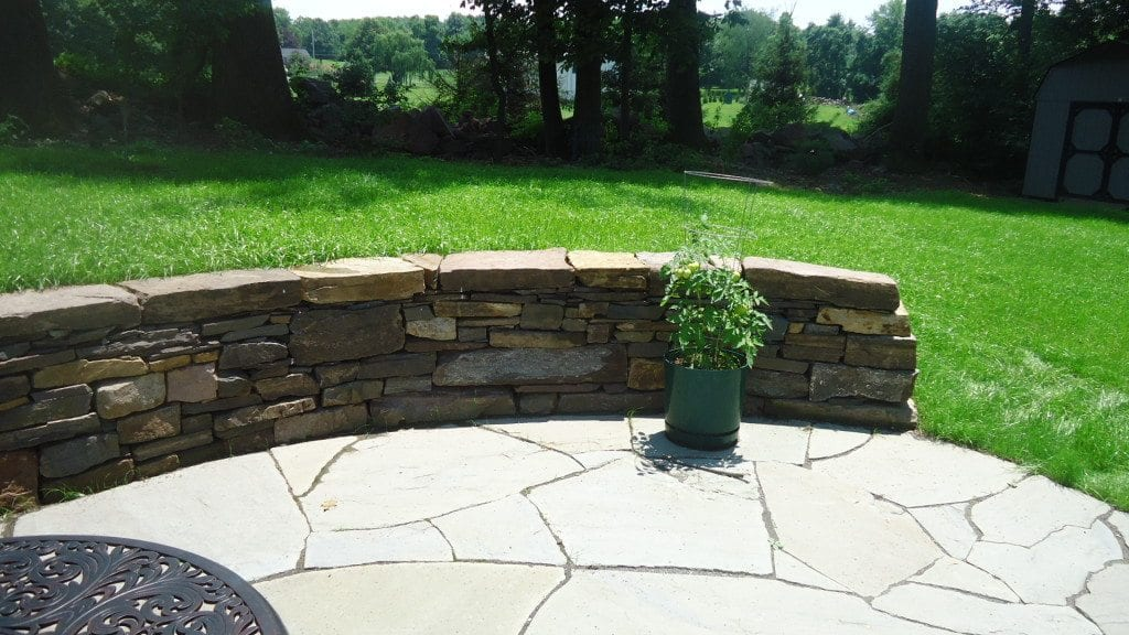 stylish yet rustic dry stone sitting wall