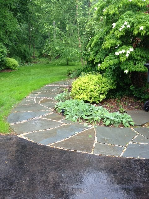 flagstone walkways with river rock