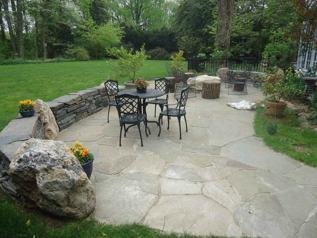 Flagstone Patio With Stone : Landscaping with stone idea incorporating boulders