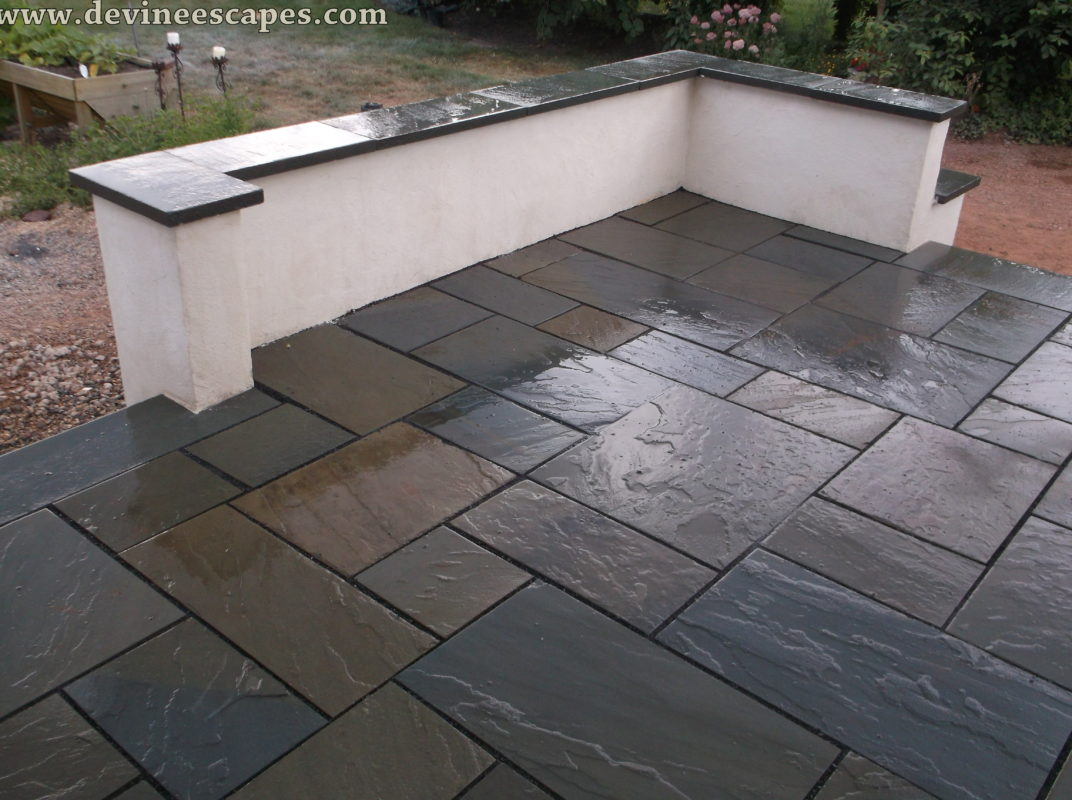 Here is a more polished look to the flagstone patio. The stones seem to be  brushed and lacquered to give a shining gleam to the stones. - 21 Eye-Catching Flagstone Patio Design Ideas