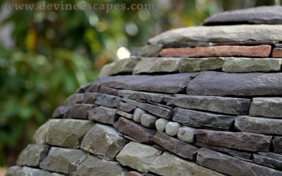 building another dry stone sphere garden sculpture