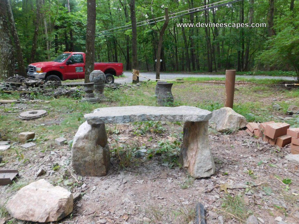careved stone bench