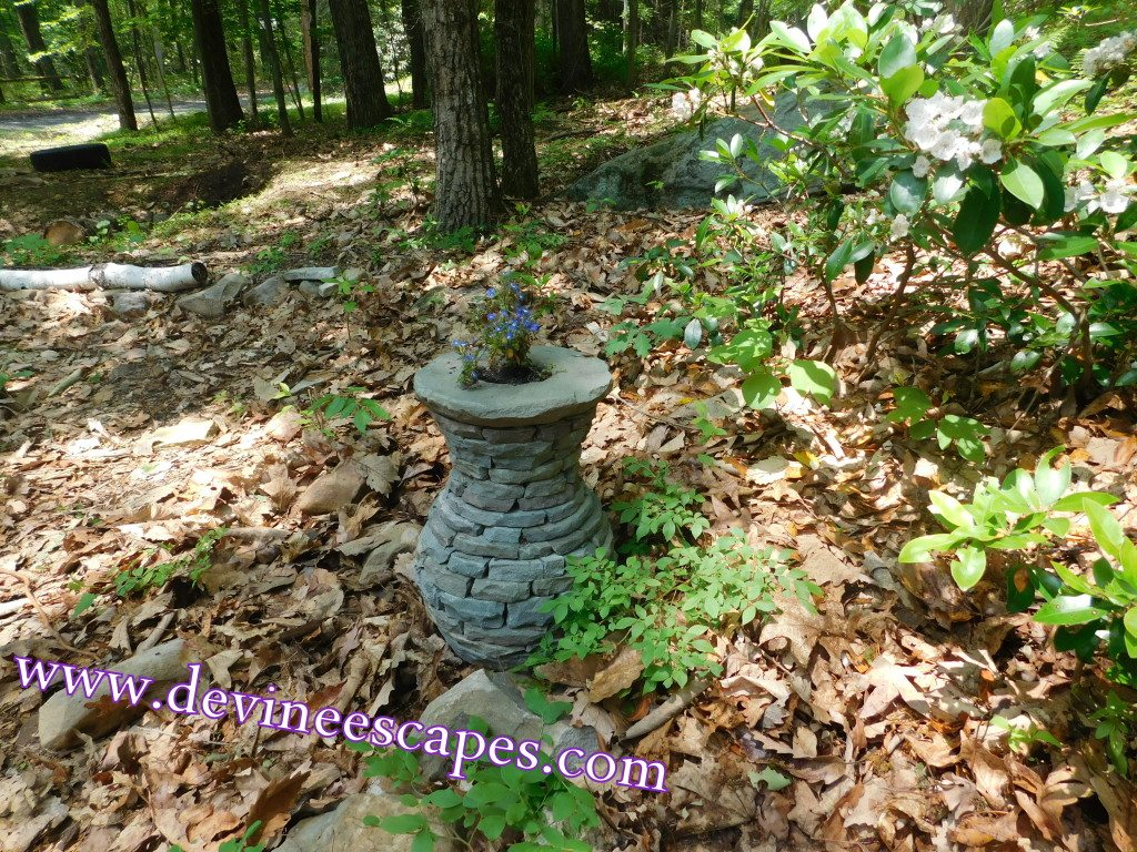 stacked stone vases, sculptures